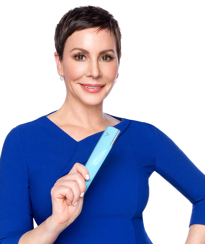 Dara Levy, founder of Dermaflash, holding the skincare device in her hand
